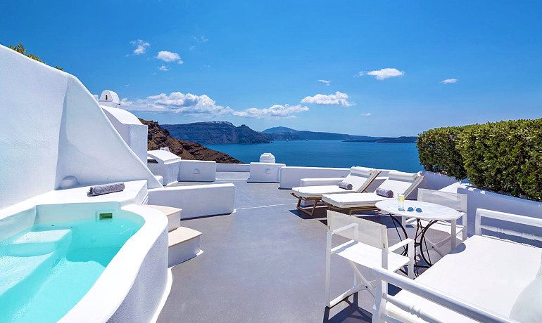 Canaves Oia Hotel sunbeds and sea view