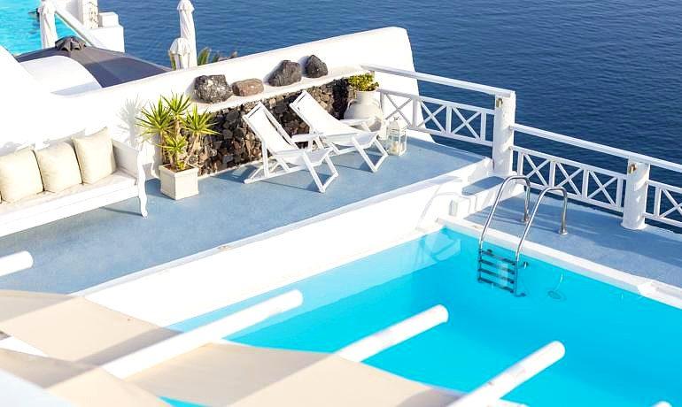 La Perla Villas & Suites pool sunbeds