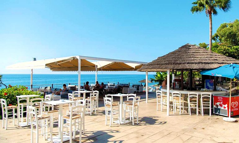 Atlantica Bay Hotel sandals beach bar