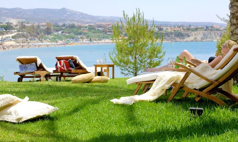 Sentido Thalassa Coral Bay sunbeds on grass