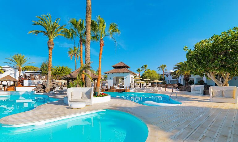 SENTIDO H10 White Suites general pool view a9d3cb3a6