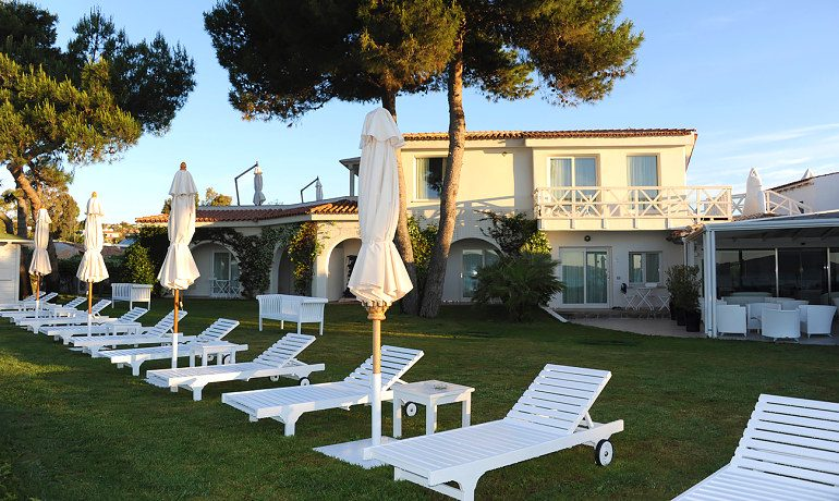The Pelican Beach Resort Spa sunbeds in garden