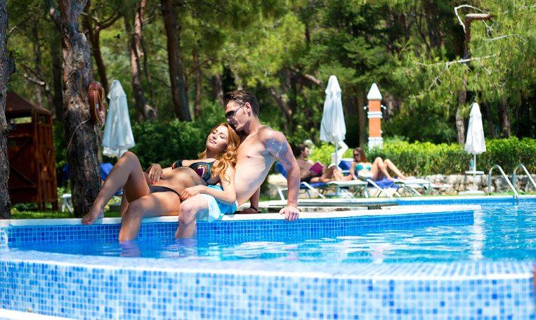 SENTIDO Lykia Resort & Spa couple at pool