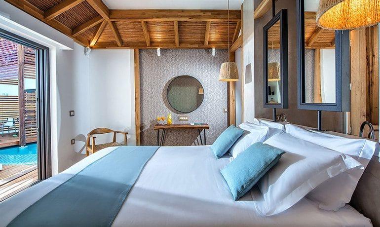 Stella Island Luxury Resort & Spa over water bungalow room