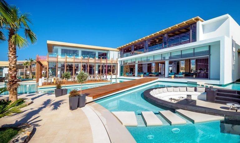Stella Island Luxury Resort & Spa pool lounge area