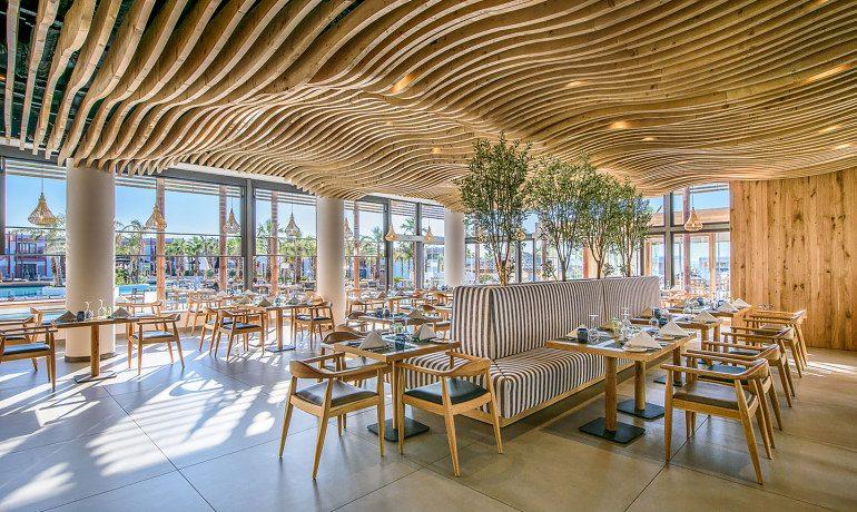 Stella Island Luxury Resort & Spa restaurant tables